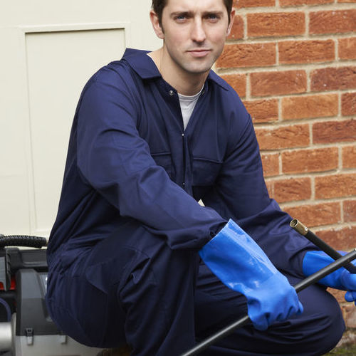 A Plumber Sets Up a Sewer Inspection Camera.