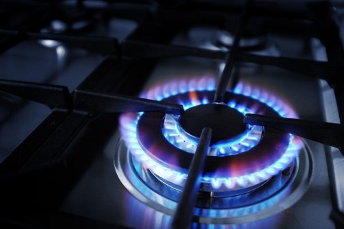 A Plumber Ensures Proper Pressure During Stove Top Use