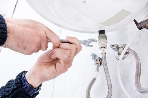 A Plumber Finishes Up Water Heater Repair